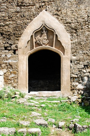 fourteenth: Southwest entrance showing the royal coat of arms in fortress dating from around the fourteenth century in Jajce, in the Bosanska Krajina region of cental Bosnia and Herzegovina. It was built by Hrvoje Vukcic Hrvatinic, the founder of Jajce. Stock Photo