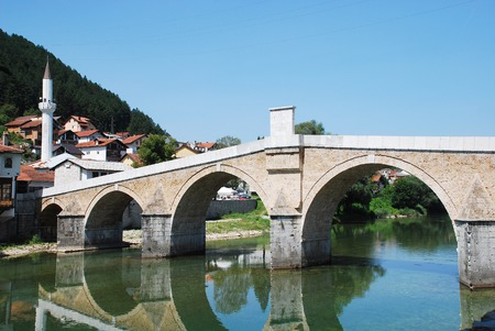 The Old Stone Bridge over the Neretva river in Konjic, northern Herzegovina, Bosnia and Herzegovina. Built in 1682, destroyed in 1945 during the war and reconstructed 2006-2009. This classical Turkish bridge is listed as a national monument. Stock Photo