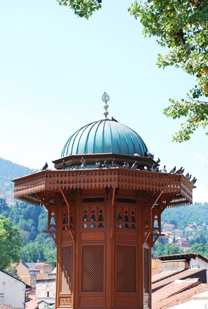 The Sebilj in Bascarsija Square, Sarajevo, Bosnia and Herzegovina. This Ottoman-style wooden fountain lies in the centre of the square and was built by Mehmed-Pasha Kukavica in 1753