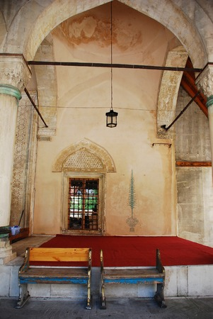 mehmed: A door and benches on the exterior of Karadjozbey Mosque in Mostar, built by Mehmed Karadjoz in 1557 Stock Photo