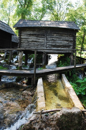 watermills: A group of disused mini wooden watermills (known as Mlincici) located on Pliva Lake (Plivska Jezera) near Jajce in the in the Bosanska Krajina region of Bosnia and Herzegovina. Stock Photo