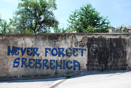 Travnik, Bosnia and Herzegovina - August 9th 2014. Graffiti on a wall near Travnik fortress referring to the Srebrenica massacre / genocidal in July 1995 in Srebrenica during the Bosnian war
