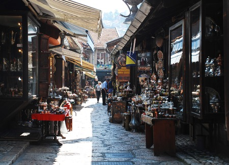 Sarajevo, Bosnia and Herzegovina - August 10th 2014. Metal goods for sale outside a tourist souvenir shop in a street in Bascarsija, Sarajevo Redakční