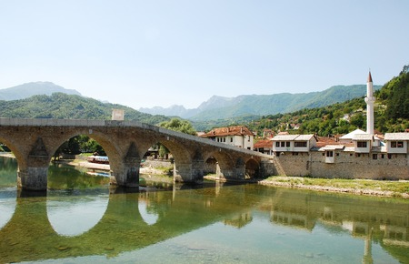 The Old Stone Bridge over the Neretva river in Konjic, northern Herzegovina, Bosnia and Herzegovina. Built in 1682, destroyed in 1945 during the war and reconstructed 2006-2009. This classical Turkish bridge is listed as a national monument. Editorial
