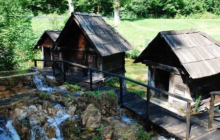 watermills: A group of disused mini wooden watermills (known as Mlincici) located on Pliva Lake (Plivska Jezera) near Jajce in the in the Bosanska Krajina region of Bosnia and Herzegovina. Stock Photo