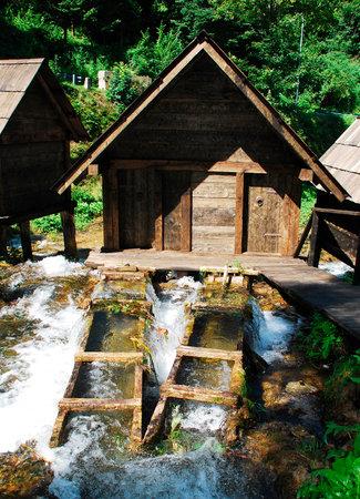 watermills: A group of disused mini wooden watermills (known as Mlincici) located on Pliva Lake (Plivska Jezera) near Jajce in the in the Bosanska Krajina region of Bosnia and Herzegovina. Editorial