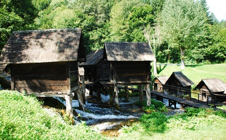 watermills: A group of disused mini wooden watermills (known as Mlincici) located on Pliva Lake (Plivska Jezera) near Jajce in the in the Bosanska Krajina region of Bosnia and Herzegovina. Editorial