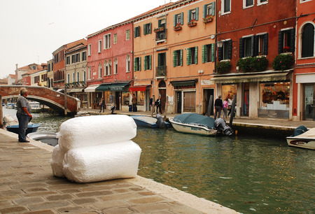 glasswork: Murano, Venice, Italy - 20th October 2014. A delivery of huge bags of polystyrene foam peices next to a canal on a chilly autumn day. The island is famous for its glasswork and large quantities of packaging material are needed for the fragile products. To Editorial