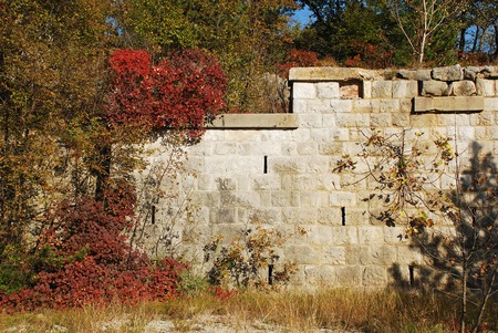 major battle: A blockhouse type World War One fortification in the Carso, a Karst limestone area in Friuli, Italy. The area was a major theatre of battle during the war and many remnants still remain today. Photograph taken showing autumn colours.