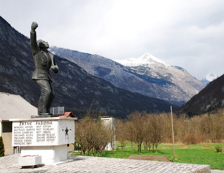mountainscape: April 6th 2015  Zaga Slovenia. A World War Two Yugoslav era war memoial overlooks a valley in present day Slovenia