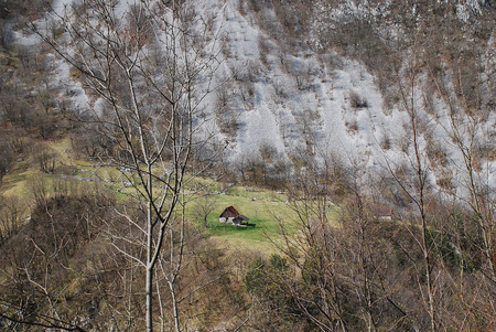 littoral: A traditional agricultural building in the hilly and mountainous landscape near Zaga in the Bovec municipality of Littoral, north west Slovenia. Taken in early April. Stock Photo