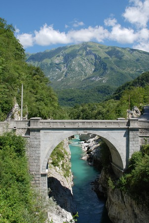 Napoleon Bridge outside the Slovenian village of Kobarid in the north west Littoral region. The bridge spans a gorge in the Soca Valley where the River Soca Isonzo flows. Reklamní fotografie