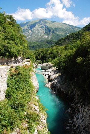 littoral: The River Soca, which runs through SLovenia and Italy where it is known as the Isonzo, flowing through the alpine landscape near the Slovenian village of Kobarid in the Littoral region.