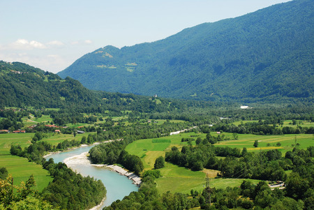 littoral: The Alpine landscape near the Slovenian village of Kobarid in the Littoral region. The Soca River, which flows through Slovenia and Italy where it is known as the Isonzo, can be seen flowing through the valley. Stock Photo