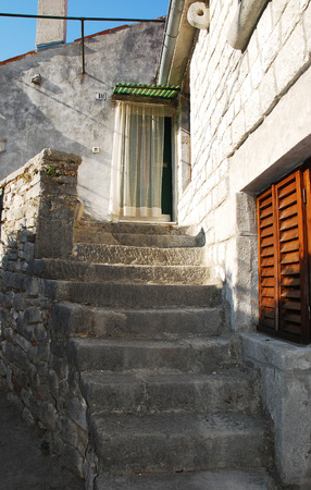 tatty: Historic old buildings in the coastal Istrian town of Labin in Croatia.