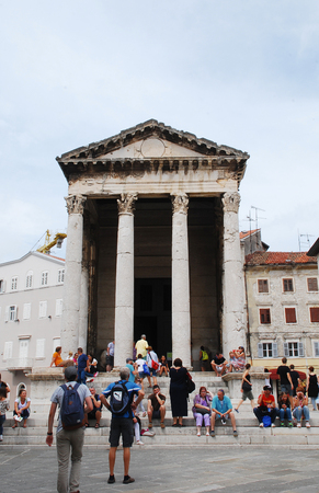 augustus: Pula, Croatia - August 24th 2015. Tourists visit the Temple of Augustus Augustov Hram in Croatian was built sometime between 2 BC and 14 AD and was dedicated to Augustus, Dedicated to the first Roman emperor.