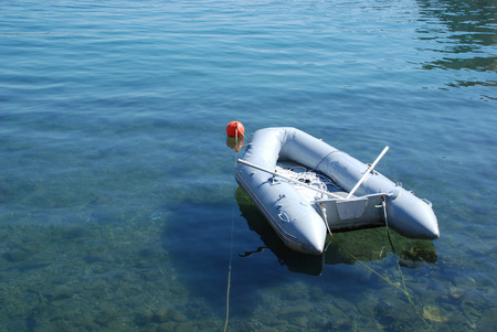 blowup: A small pale blue inflatable dinghy in the waters of Bakar bay in western Croatia.