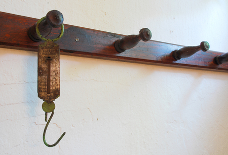 ing: An antique meat scale hook. These old hanging scales were previously used to weigh meat.