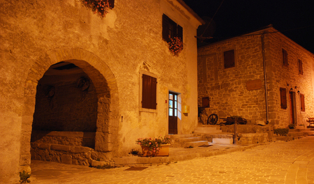 kerb: A night time shot of a street in the historic medieval Croatian village of Gracisce in central Istria.