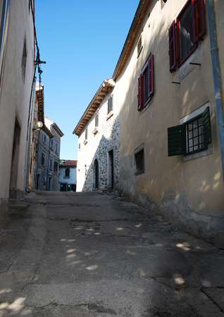 tatty: Historic old buildings in the coastal Istrian town of Labin in Croatia.
