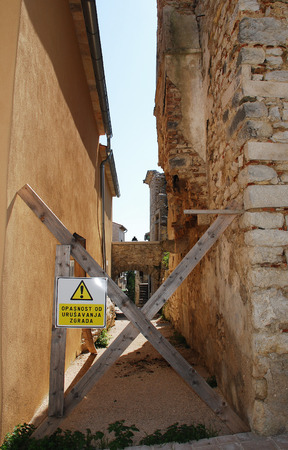 unsafe: A closed street in the Croatian medievel hill village of Pican in cental Istria. A large percentage of the buildings in this village are now derelict or abandoned and are considered unsafe.