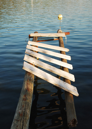 waters: An old wooden boardwalk juts out into the waters in the bay at Bakar in western croatia.