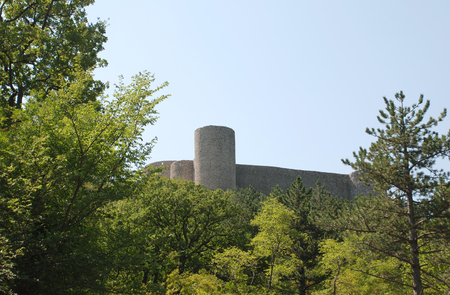middle ages: This Frankopan castle near Bakar in Croatia was built in the Middle Ages between the 13th and 18th centuries, and has a rectangular layout with circular corner towers. Stock Photo