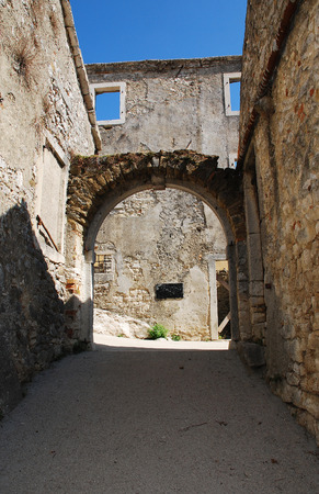tatty: A street in the Croatian medievel hill village of Pican in cental Istria.  Stock Photo