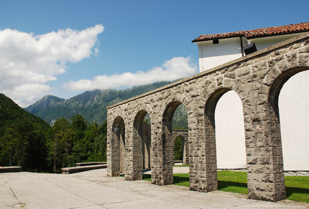 solders: Arches of the Italian Charnal House located on Gradic Hill in Kobarid, in the Littoral region of north east Slovenia. Opened in 1938, it contains the remains of 7,000 Italian solders who were killed in the First World War. The white walls of the church Ko