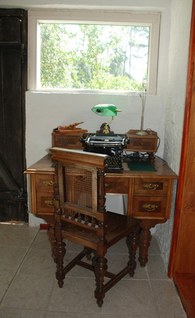key cabinet: An antique manual typewriter on a antique wooden desk. Stock Photo