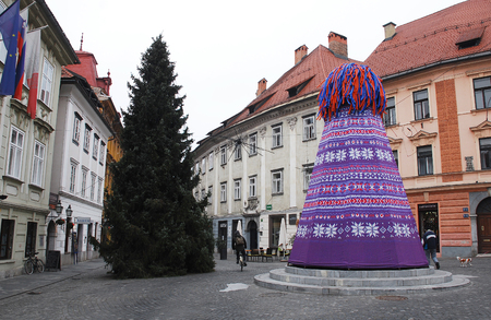 Ljubljana, Slovenia - December 12th 2015. The Robba Fountain, also known as Robbov Vodnjak or Fountain of the Three Carniolan Rivers, is decorated in a winter hat to protect it against freezing at the junction between Stari Trg and Gornji Trg.