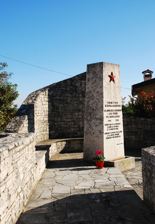 former yugoslavia: A memorial to the victims of World War 2 in San Michele Del Carso in present day Italy. The town was part of the former Yugoslavia during the war and the text is written in both Italian and Slovenian.