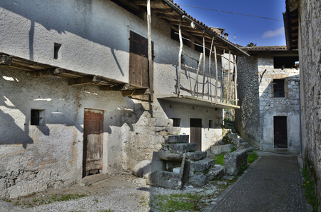 eighteenth: Old derelict buildings in the village of Somp Cornino in Friuli Venezia Giulia, Italy. These historic farmhouse buildings date back to the eighteenth century.
