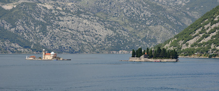 abbeys: The islands of Our Lady of the Rock on the left and St Georges Abbey on the right in Kotor Bay, Montenegro. The former was artificially created by locals using rocks, the later is also known as the Island of the Dead, and contains a 12th century Benedict Stock Photo