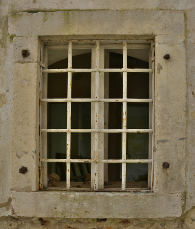 tatty: A window in an old building in the historic Montenegrin town of Herceg Novi. Stock Photo
