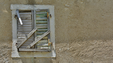 tatty: A window in an old derelict building in the historic Montenegrin town of Kotor. Stock Photo