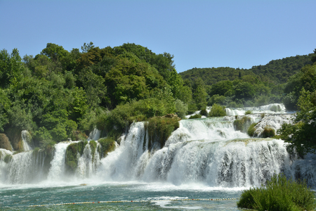 Skradinski Buk waterfall on the River Krka in Krka National Park, Sibenik-Knin County, Croatia. The  waterfall consists of travertine barriers and a total of 17 different water falls, it is considered to be one of the most beautiful calcium carbonate wate