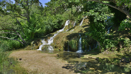 slap: A small waterfall near Roski Slap waterfall on the River Krka in Krka National Park, Sibenik-Knin County, Croatia. Stock Photo