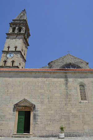 clocktower: An old church in the historic Montenegrin coastal town of Perast Stock Photo