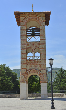 belltower: The Belltower next to the Hercegovacka Gracanica Monastery on Crkvina Hill above Trebinje in Bosnia. The monastery was built in 2000 and is an exact copy of the Gracanica Monastery in Kosovo. Stock Photo