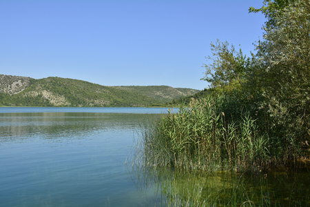 waterscapes: The landscape near Visovac Island in the River Krka in Krka National Park, Sibenik-Knin County, Croatia.