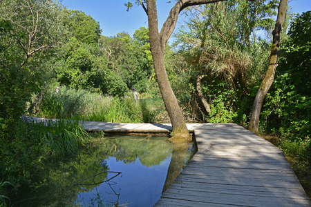 river county: A wooden walkway on the River Krka in Krka National Park, Sibenik-Knin County, Croatia. It is part of the    part of the 1900m Skradinski Buk Waterfall trail Stock Photo