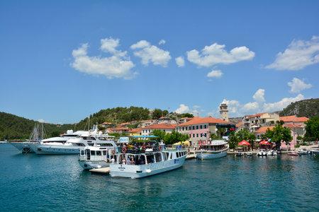 Skadin, Croatia - July 2nd 2016. Boats heading towards Krka National Park await tourists at the start of the tourist season in the small town of Skradin on the coast of the Sibenik-Knin County of Croatia.