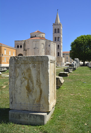 St Donatus Church, the largest pre-Romanesque building in Croatia, was constructed in the 9th and 10th centuries. Part of the Roman Forum can be seen in the foreground, and the spire of St Anastasias Cathedral can be seen behind the church. Stock Photo