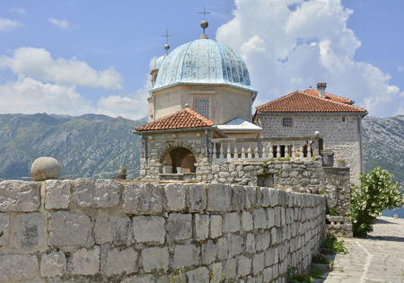 artificially: The Our Lady of the Rock island in Kotor Bay, Montenegro. The island was artificially created and includes a small Roman Catholic church.