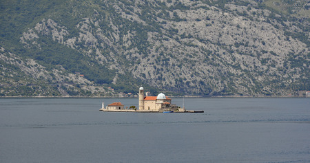 catholocism: The Our Lady of the Rock island in Kotor Bay, Montenegro. The island was artificially created and includes a small Roman Catholic church.