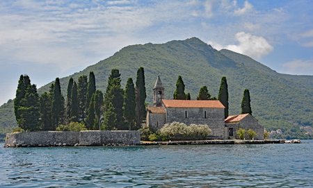 waterscapes: The tiny St Georges Island in Kotor Bay, Montenegro, also known as the Island of the Dead. The island contains a 12th century Benedictine abbey and a cemetery.
