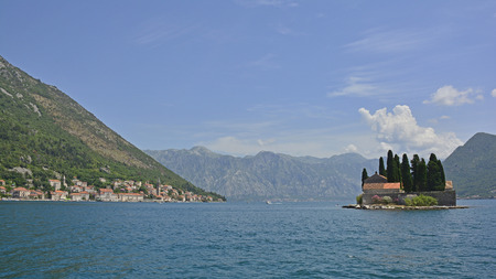 abbeys: The tiny St Georges Island in Kotor Bay, Montenegro, also known as the Island of the Dead. The island contains a 12th century Benedictine abbey and a cemetery. The village of Perast can be seen on the coast in the background