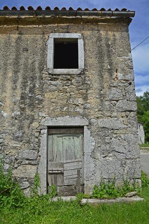 derelict: A derelict farming building in the historic village of Jelovice in Primorje-Gorski Kotar County in northern Croatia.