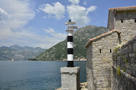 waterscapes: The historic Gospa od Andela Church - Our Lady of the Angels - in Kotor Bay, Montenegro. The church is believed to date fom 1584, and has recently been restored. Two islands - Our Lady of the Rock and St Georges Abbey - can be seen in the distance along
